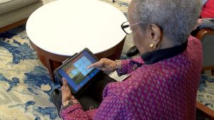 Older adult using the Birdsong touch screen tablet