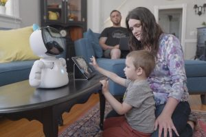 young boy with his parents using the Kebbi robot at home